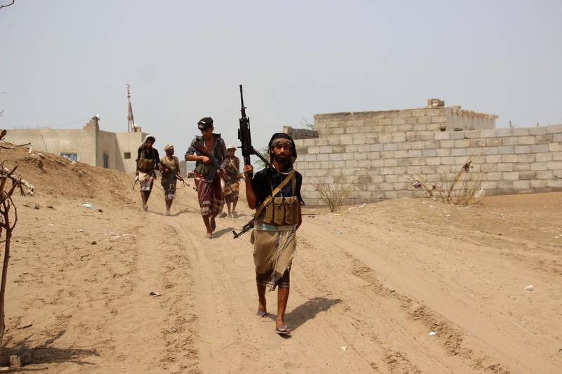 epa07004138 Yemeni government forces take part in military operations on Houthi positions in the port province of Hodeidah, Yemen, 07 September 2018. According to reports, heavy fighting is currently taking place at Yemeni Hodeidah city's western and southern outskirts between the Saudi-backed Yemeni forces and the Houthi rebels as UN-sponsored peace talks in Geneva failed to get off the ground, with the Houthi delegation refusing to leave the capital Sana'a.  EPA/NAJEEB ALMAHBOOBI