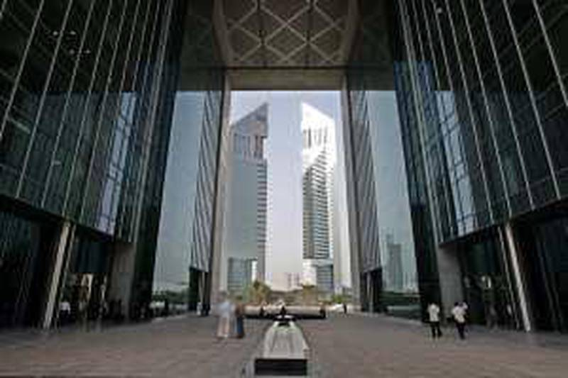 With the Emirates Towers in background, people arrive at the Gate, located at the Dubai International Financial Center, DIFC,  in Dubai, United Arab Emirates, July 12, 2006. More than three dozen international financial firms have set up offices in this Gulf city's futuristic new financial district, which is governed by its own rules, has its own courts and does business in U.S. dollars. (AP Photo/Kamran Jebreili)