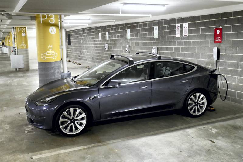 SYDNEY, AUSTRALIA - JANUARY 19: A Tesla Model Y charges at a EV charge station in Lane Cove on January 19, 2021 in Sydney, Australia. Share prices for lithium miners and battery makers continue to rise as global demand for electric vehicles continues to grow. Lithium is a key component for batteries in electric cars. (Photo by Brendon Thorne/Getty Images)