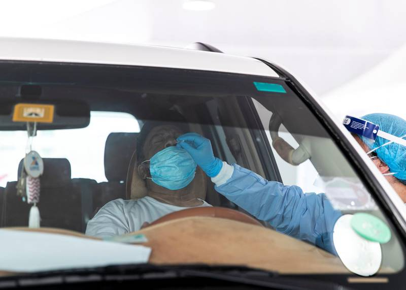 Ras Al Khaimah, UNITED ARAB EMIRATES. 30 APRIL 2020. A visitor gets tested at SEHA's Ras Al Khaimah Covid-19 drive-through testing centre.(Photo: Reem Mohammed/The National)Reporter:Section: