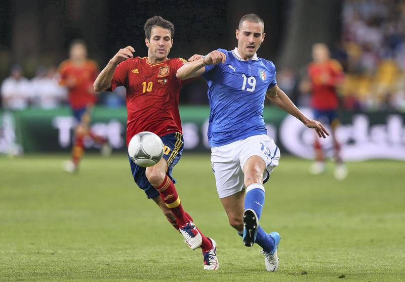 KIEV, UKRAINE - JULY 01: Cesc Fabregas (L) of Spain and Leonardo Bonucci of Italy during the UEFA EURO 2012 final match between Spain and Italy at the Olympic Stadium on July 1, 2012 in Kiev, Ukraine.  (Photo by Alex Livesey/Getty Images)