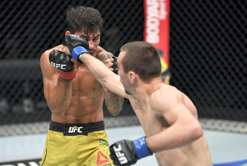 ABU DHABI, UNITED ARAB EMIRATES - JULY 19: (R-L) Askar Askarov of Russia punches Alexandre Pantoja of Brazil in their flyweight bout during the UFC Fight Night event inside Flash Forum on UFC Fight Island on July 19, 2020 in Yas Island, Abu Dhabi, United Arab Emirates. (Photo by Jeff Bottari/Zuffa LLC via Getty Images)