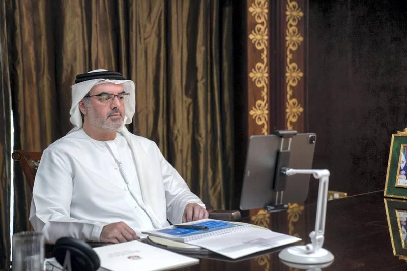 ABU DHABI, UNITED ARAB EMIRATES - November 22, 2020: HH Sheikh Mohamed bin Khalifa Al Nahyan, Abu Dhabi Executive Council Member (C) attends a virtual Supreme Petroleum Council meeting.  ( Rashed Al Mansoori / Ministry of Presidential Affairs ) ---
