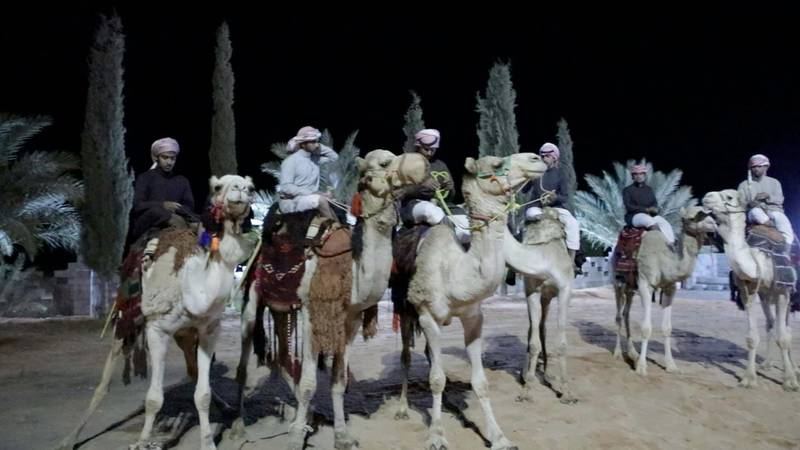 Members of the Al Faqeer tribe await their visitors on camels. Suhail Rather/TheNational