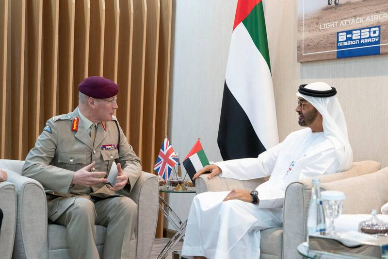 ABU DHABI, UNITED ARAB EMIRATES - February 18, 2019: HH Sheikh Mohamed bin Zayed Al Nahyan, Crown Prince of Abu Dhabi and Deputy Supreme Commander of the UAE Armed Forces (R) meets with Lieutenant General Sir John Lorimer, UK's Defence Senior Advisor to the Middle East (L), during the 2019 International Defence Exhibition and Conference (IDEX), at Abu Dhabi National Exhibition Centre (ADNEC). ( Rashed Al Mansoori / Ministry of Presidential Affairs ) ---