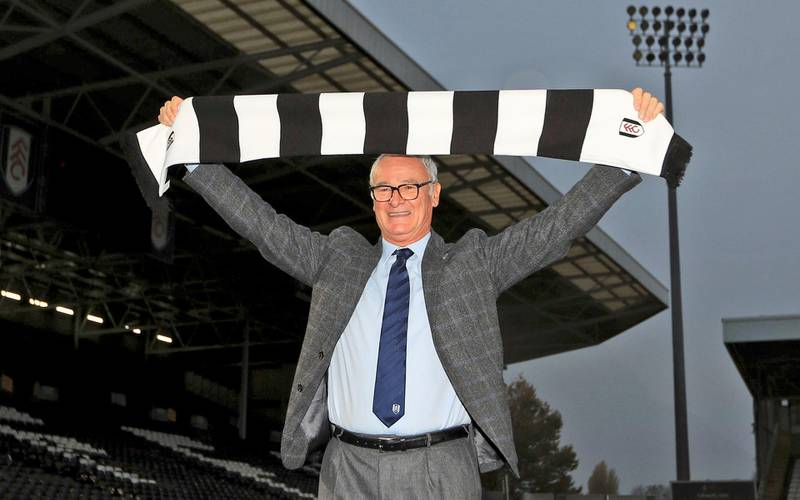 Claudio Ranieri poses for photographs during the press conference at Fulham's Craven Cottage stadium in London, Friday Nov. 16, 2018. Ranieri was is appointed as manager for struggling English Premier League club Fulham. (Simon Cooper/PA via AP)