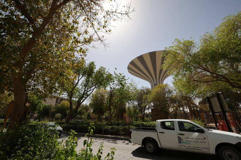 """Cars drive by on a tree-lined road in the Saudi capital Riyadh, on March 29, 2021. - Although the OPEC kingpin seems an unlikely champion of clean energy, the """"Saudi Green Initiative"""" aims to reduce emissions by generating half of its energy from renewables by 2030. (Photo by Fayez Nureldine / AFP)"""