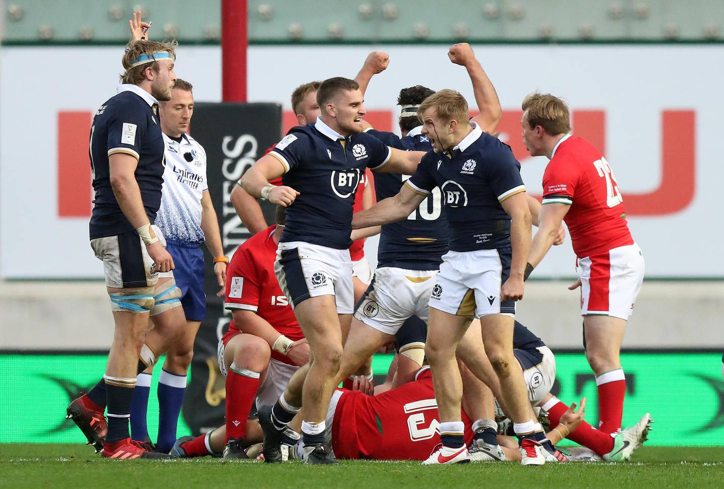 LLANELLI, WALES - OCTOBER 31: James Lang of Scotland (2L) celebrates with Scott Steele of Scotland as a penalty is awarded in final play to secure victory in  the 2020 Guinness Six Nations match between Wales and Scotland at Parc y Scarlets on October 31, 2020 in Llanelli, Wales. Sporting stadiums around the UK remain under strict restrictions due to the Coronavirus Pandemic as Government social distancing laws prohibit fans inside venues resulting in games being played behind closed doors. (Photo by David Rogers/Getty Images)