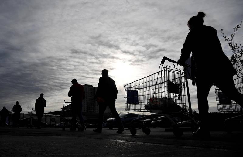 FILE PHOTO: Shoppers queue to enter a Tesco supermarket, as the spread of the coronavirus disease (COVID-19) continues, in West London, Britain, March 20, 2020. REUTERS/Toby Melville/File Photo