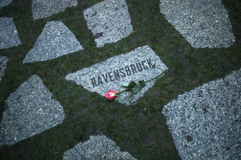 BERLIN, GERMANY - JANUARY 29:  A flower lies at a stone that refers to the former Ravensbrueck concentration camp at the Memorial to the Sinti and Roma Victims of National Socialism following a commemoration ceremony on January 29, 2018 in Berlin, Germany. The ceremony paid tribute to the estimated 220,000 to 500,000 Sinti and Roma victims, also called Gypsies, who died at the hands of the Nazis during the Holocaust. Ravensbrueck, located in central Germany, was primarily a concentration camp for women.  (Photo by Sean Gallup/Getty Images)
