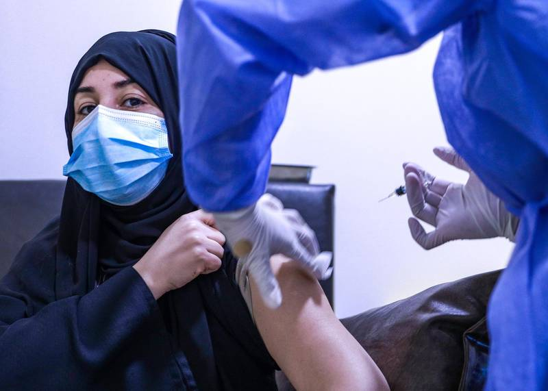 Abu Dhabi, United Arab Emirates, December 13, 2020.  Aysha Mohammed Ahmad Ali went to Abu Dhabi from Al Ain to get vaccinated at the Burjeel Hospital.Victor Besa/The NationalSection:  NA
