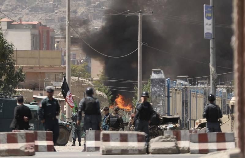 epa06961791 Flames rise after armed militants attacked the area close to the Presidential place and other government offices, during Eid al-Adha celebrations in Kabul, Afghanistan, 21 August 2018. Afghan security forces are engaged in an operation to clear the area of militants.  EPA/JAWAD JALALI