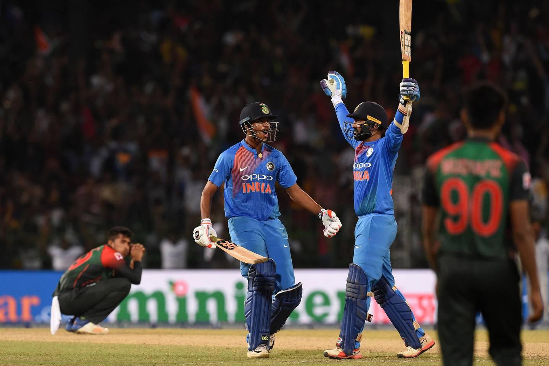 Indian cricketer Dinesh Karthik (2nd R) and Washington Sundar (2nd L) react after scoring the winning run to defeat Bangladesh by 4 wickets during the final Nidahas Twenty20 Tri-Series international cricket match between India and Bangladesh at the R. Premadasa stadium in Colombo on March 18, 2018. / AFP PHOTO / ISHARA S. KODIKARA
