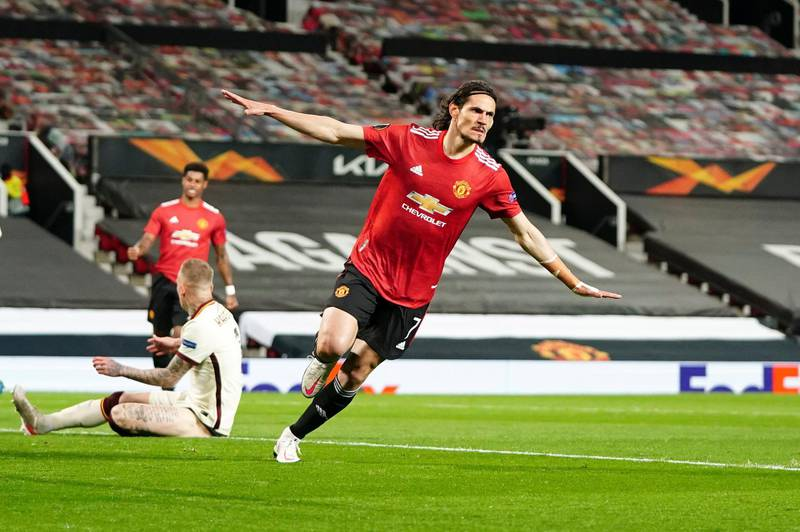 Manchester United's Edinson Cavani celebrates after scoring his side's second goal during the Europa League semi final, first leg soccer match between Manchester United and Roma at Old Trafford in Manchester, England, Thursday, April 29, 2021. (AP Photo/Jon Super)