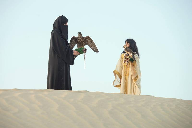 Ayesha Mattar Al Mansoori began learning falconry from her father at the age of 4. Now she is passing that knowledge on to her daughter Osha, Ayesha raised her daughter Osha with falcons since infancy at Abu Dhabi,UAE, Vidhyaa Chandramohan for The National