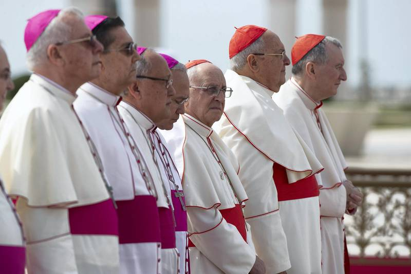 ABU DHABI, UNITED ARAB EMIRATES - February 4, 2019: Day two of the UAE papal visit - Members of the Vatican delegationstand for a national anthem during an official reception at the Presidential Palace.  ( Ryan Carter / Ministry of Presidential Affairs ) ---