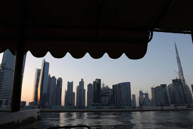 DUBAI , UNITED ARAB EMIRATES – May 17 , 2017 : View of the Dubai Skyline from the Abra at Dubai Water Canal in Dubai. The ticket price for one trip is 25 AED per person and the total time of this ride is around 45 minutes. People can see the Burj Khalifa and other buildings from Abra during the ride. ( Pawan Singh / The National ) For News / Photo Feature. ID No :- 18945 *** Local Caption ***  PS1705- DUBAI CANAL19.jpg