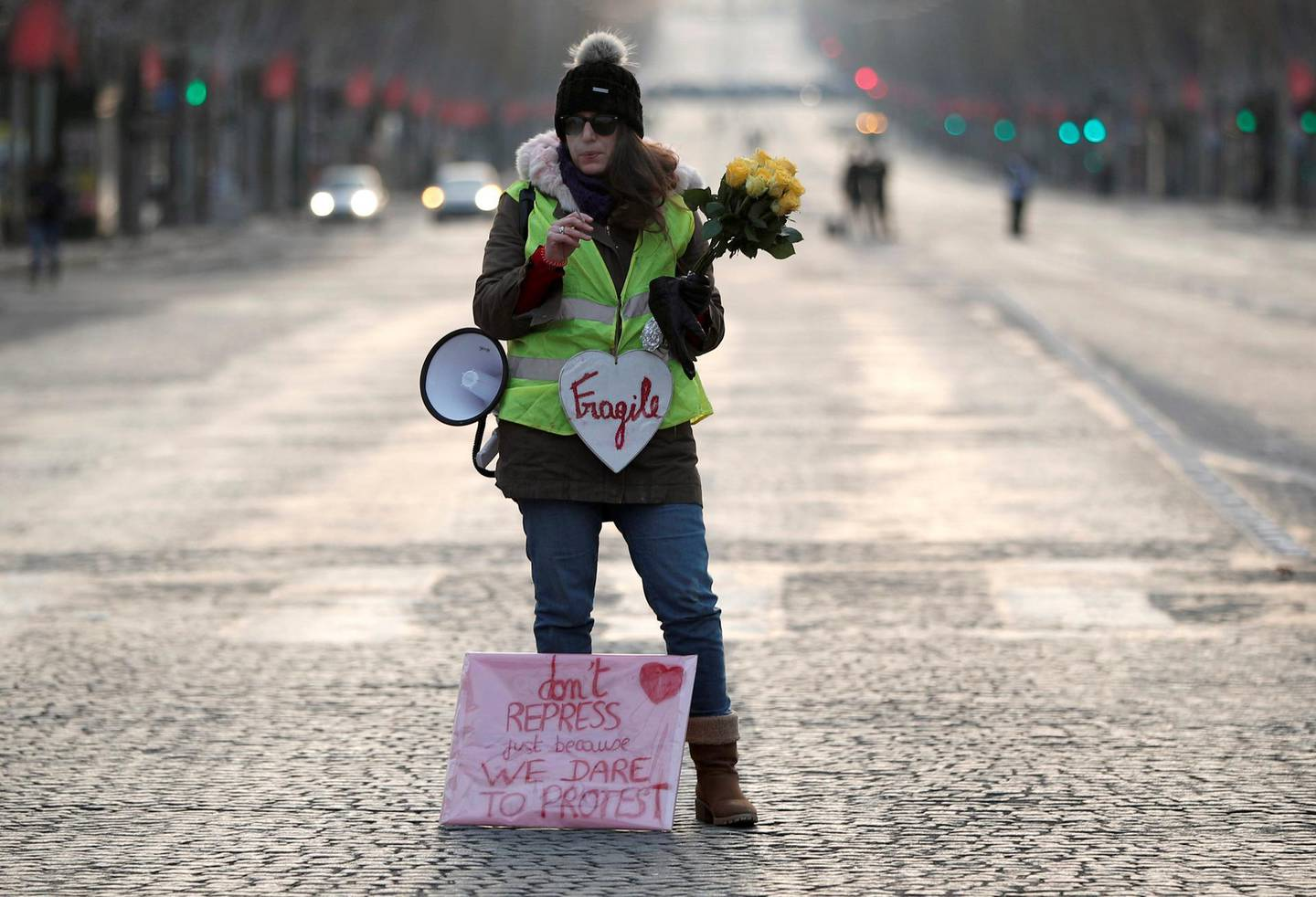 """A protester wearing a yellow vest stands before taking part in a demonstration by the """"yellow vests"""" movement on the Champs-Elysees Avenue in Paris, France, December 15, 2018. REUTERS/Benoit Tessier"""