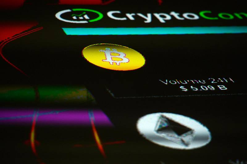 The symbols for Bitcoin and Ethereum cryptocurrency sit displayed on a screen during the Crypto Investor Show in London, U.K., on Saturday, March 10, 2018. The meeting is the largest crypto and blockchain event for investors in the U.K. Photographer: Mary Turner/Bloomberg