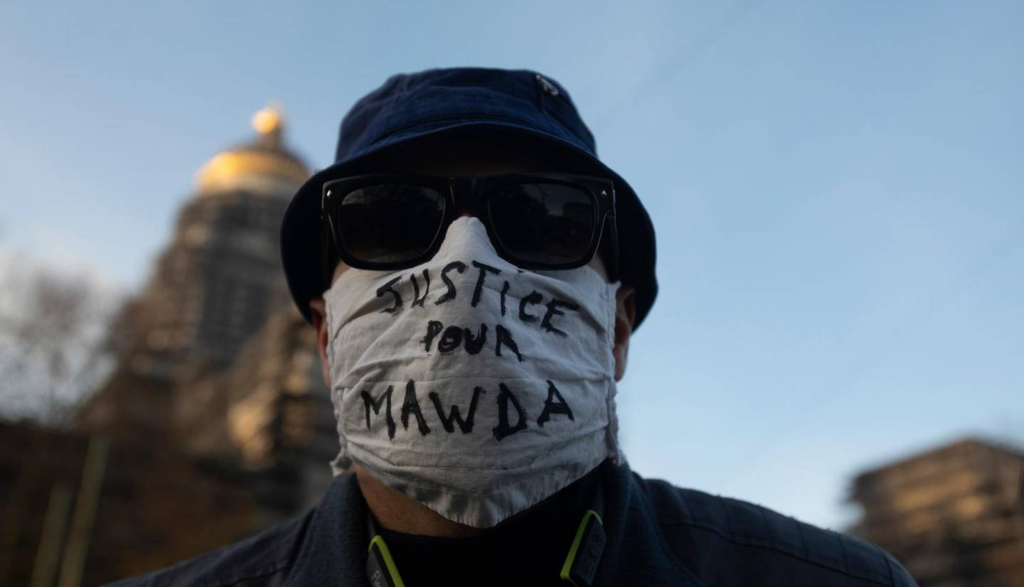 A man wears a protective face mask as he attends a solidarity event for Mawda Shawri at the courthouse in Brussels, Monday, Nov. 23, 2020. A trial opened on Monday in the shooting death of two-year old toddler, Mawda Shawri, who was in a van during a high-speed chase between police and suspected migrant smugglers seeking to get to Britain. At the trial in Belgium's southern Mons, a policeman stands accused of involuntary manslaughter and two other men for being suspected migrant smugglers. (AP Photo/Virginia Mayo)