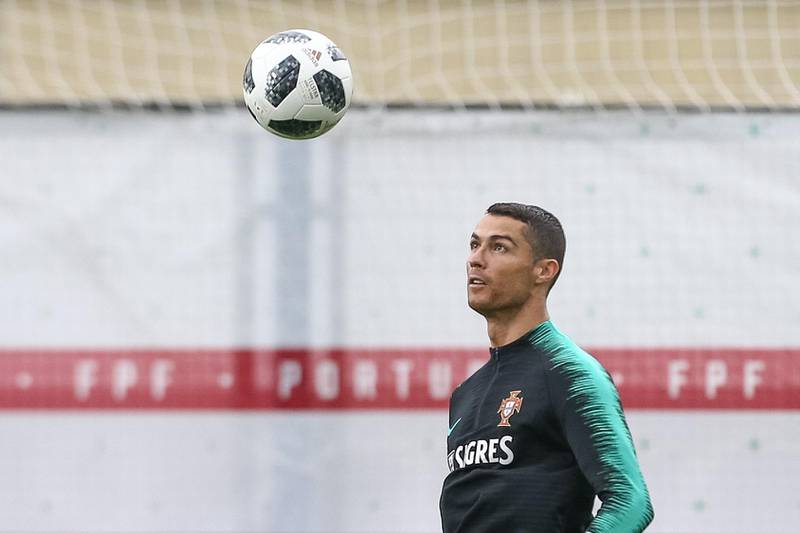epa06803917 Portugal national team player Cristiano Ronaldo during a training session at the Kratovo training camp, which will be the team base camp during the FIFA World Cup 2018 in Russia, Ramensky, Moscow, Russia, 13 June 2018.  EPA/PAULO NOVAIS