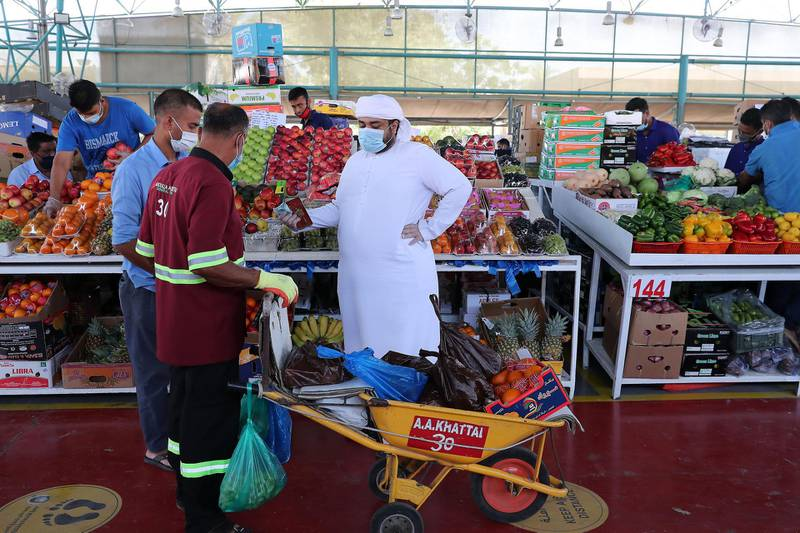 DUBAI, UNITED ARAB EMIRATES , May 5 – 2020 :- People wearing protective face mask at the Al Awir fruit & vegetable market in Dubai. UAE government ease the coronavirus restriction for the residents around the country. (Pawan Singh / The National) For News/Standalone/Online/Stock
