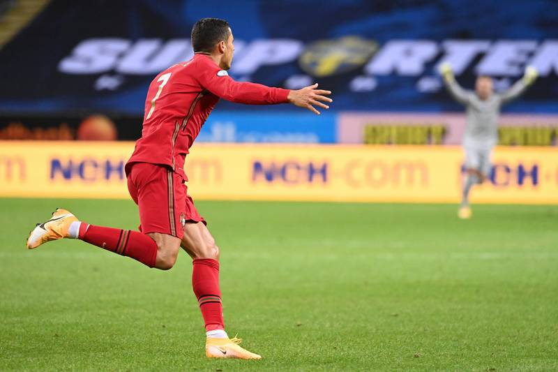 Portugal's forward Cristiano Ronaldo celebrates scoring the opening goal, his 100th goal for Portugal, during the UEFA Nations League football match between Sweden and Portugal on September 8, 2020 in Solna, Sweden. (Photo by Jonathan NACKSTRAND / AFP)