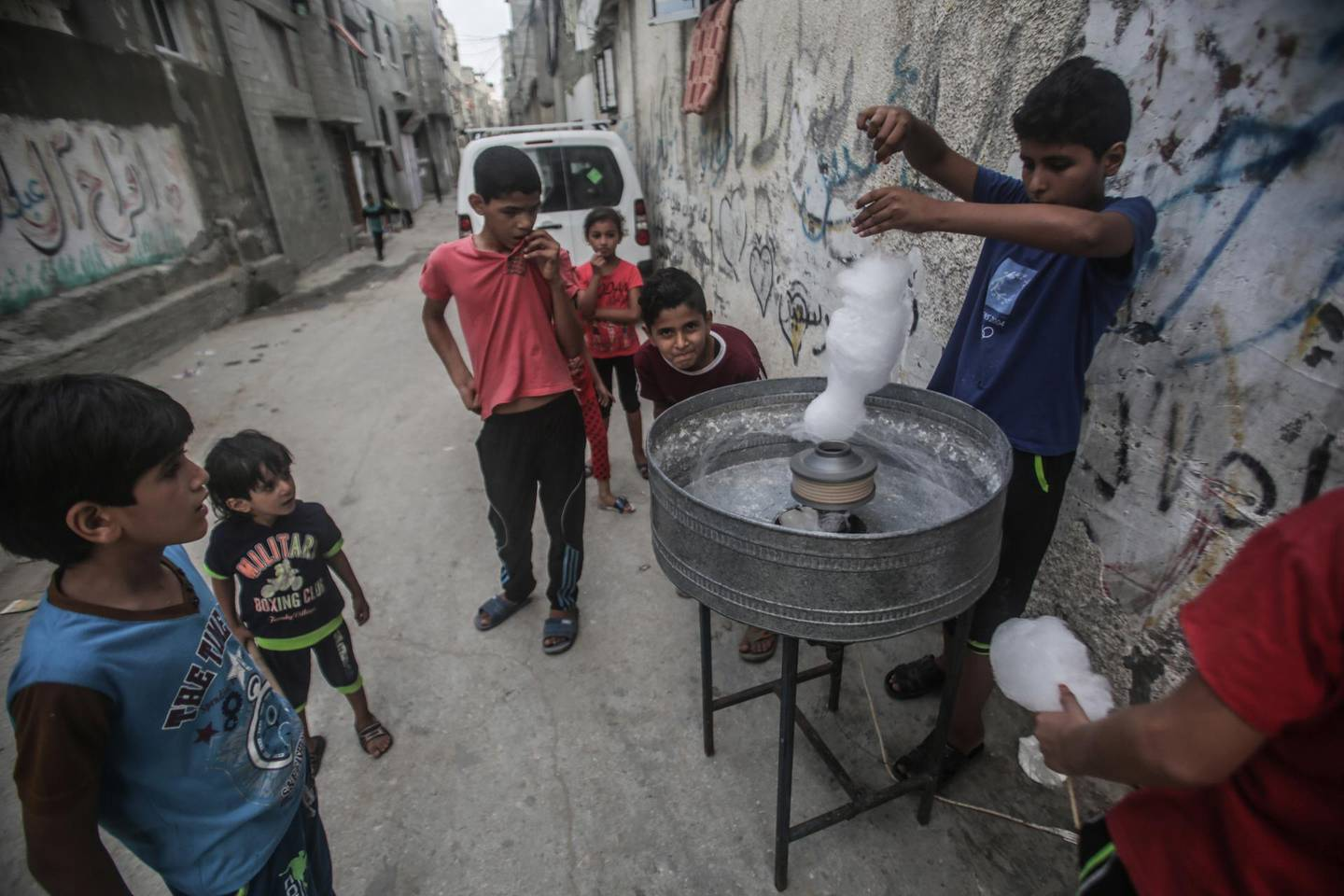 epa06991149 Palestinians refugees making candy floss in the Shateaa refugee camp in the north west Gaza City, 01 September 2018. According to media reports on 31 August 2018, the United States has ended all funding to the United Nations Relief and Works Agency for Palestine Refugees in the Near East (UNRWA). 'The administration has carefully reviewed the issue and determined that the United States will not make additional contributions to UNRWA' according to a statement by the US State Department.  EPA/HAITHAM IMAD