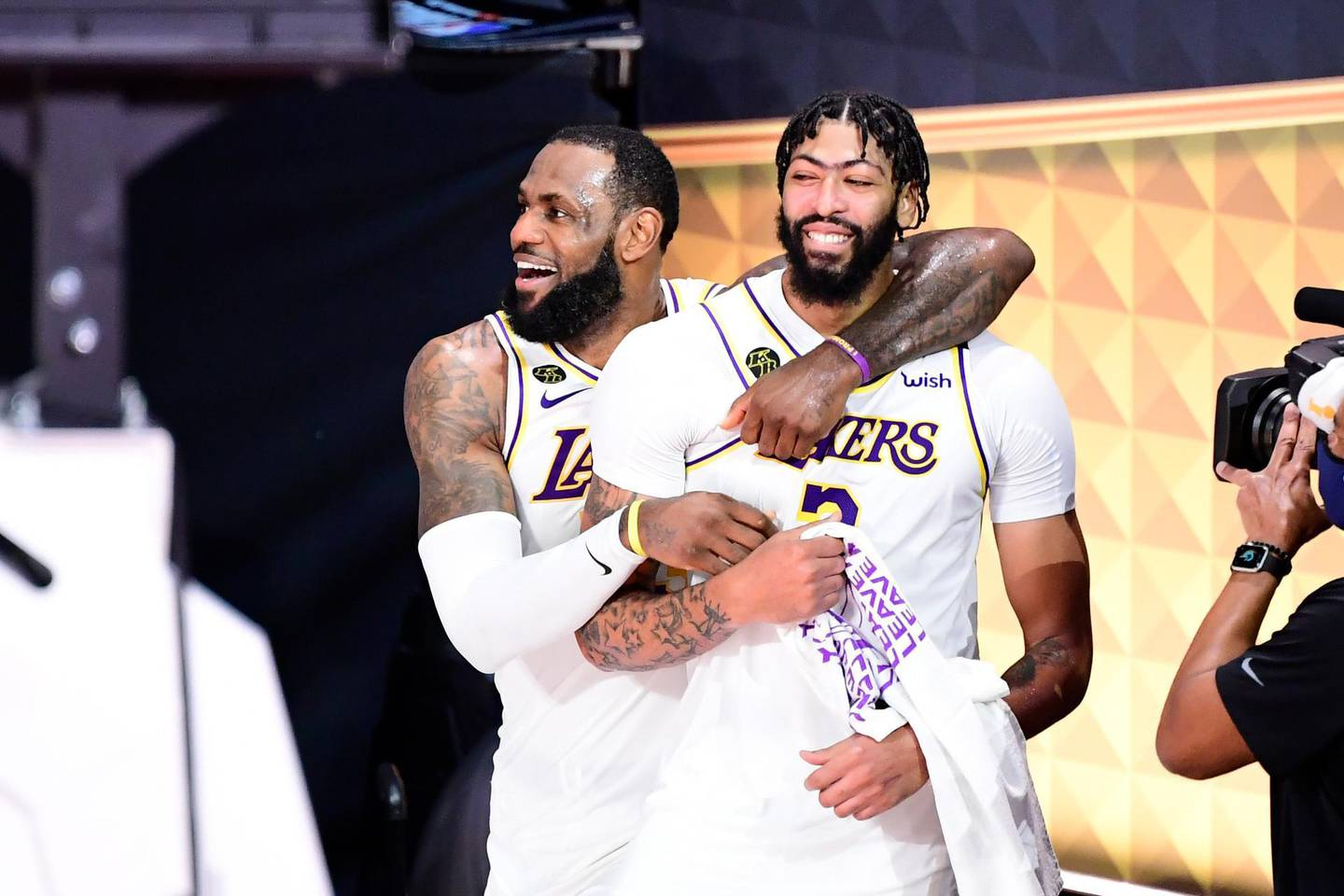 LAKE BUENA VISTA, FLORIDA - OCTOBER 11: LeBron James #23 of the Los Angeles Lakers and Anthony Davis #3 of the Los Angeles Lakers react after winning the 2020 NBA Championship in Game Six of the 2020 NBA Finals at AdventHealth Arena at the ESPN Wide World Of Sports Complex on October 11, 2020 in Lake Buena Vista, Florida. NOTE TO USER: User expressly acknowledges and agrees that, by downloading and or using this photograph, User is consenting to the terms and conditions of the Getty Images License Agreement.   Douglas P. DeFelice/Getty Images/AFP