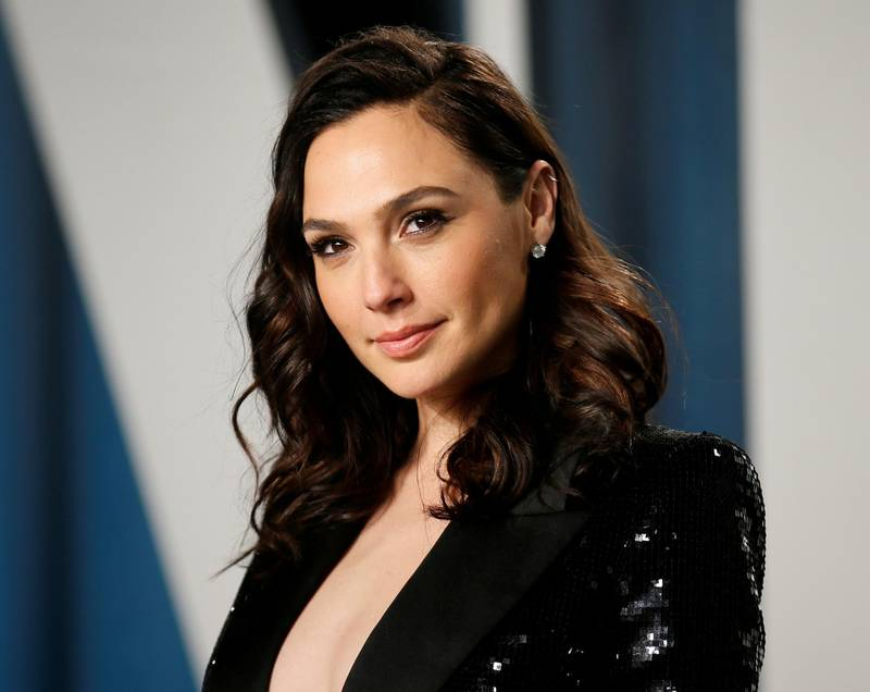 """FILE PHOTO: Gal Gadot attends the Vanity Fair Oscar party in Beverly Hills during the 92nd Academy Awards, in Los Angeles, California, U.S., February 9, 2020. Gadot stars in """"Wonder Woman 1984"""" which is set for release on Dec. 25, 2020.  REUTERS/Danny Moloshok/File Photo"""