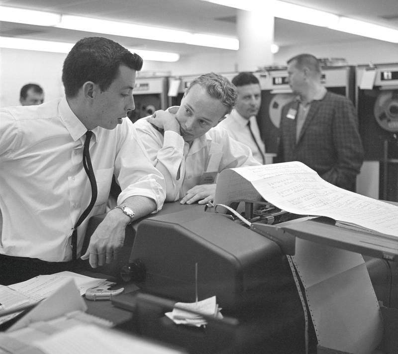 This archival image shows engineers at NASA's Jet Propulsion Laboratory looking at data related to the Venus flyby of Mariner 2 on Dec. 14, 1962. This was the first successful flyby of another planet.