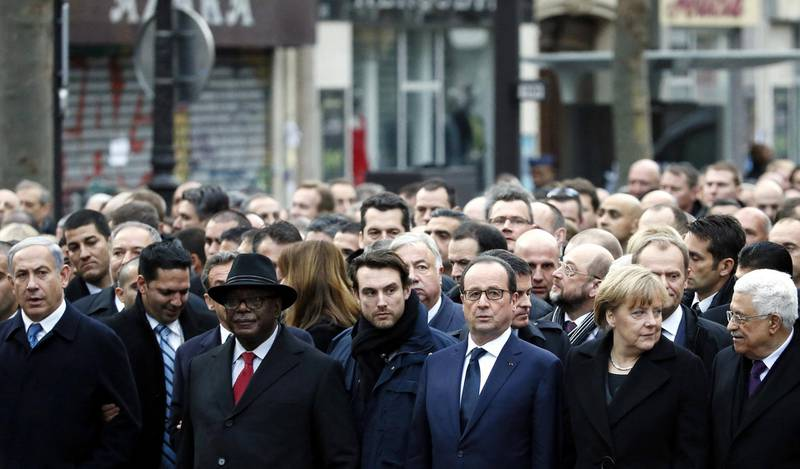 """(From L) Israeli Prime Minister Benjamin Netanyahu, Malian President Ibrahim Boubacar Keita, bodyguard, French President Francois Hollande, German Chancellor Angela Merkel and Palestinian president Mahmud Abbas take part in a Unity rally """"Marche Republicaine"""" in Paris on January 11, 2015 in tribute to the 17 victims of a three-day killing spree by homegrown Islamists. The killings began on January 7 with an assault on the Charlie Hebdo satirical magazine in Paris that saw two brothers massacre 12 people including some of the country's best-known cartoonists, the killing of a policewoman and the storming of a Jewish supermarket on the eastern fringes of the capital which killed 4 local residents. AFP PHOTO / PATRICK KOVARIK (Photo by PATRICK KOVARIK / AFP)"""