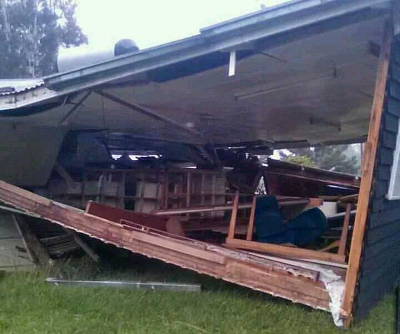 A house sits collapsed following a strong earthquake, Tuesday, Feb. 27, 2018, in Halagoli, Hela Province, Papua New Guinea. Severe damage after Monday's powerful 7.5 magnitude earthquake in Papua New Guinea is hindering efforts to assess the destruction, although officials fear dozens of people may have been injured or killed. (Jerol Wepii via AP)