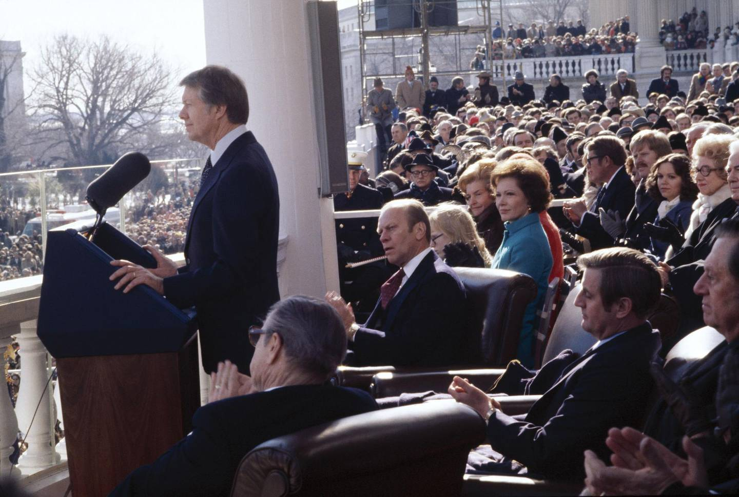 WASHINGTON - JANUARY 20:  (NO U.S. TABLOIDS) U.S. President Jimmy Carter makes his inaugural speech after being sworn in on January 20, 1977 on the East Portico of the U.S. Capitol, Washington, D.C. Sitting (counter-clockwise from bottom) are Vice President Nelson A. Rockefeller (back to camera), Vice President-elect Walter Mondale, First Lady Roselyn Carter (in blue), former First Lady Betty Ford (behind right of Mrs Carter) and former President Gerald R. Ford (C). Chief Justice Warren E. Burger (not pictured) administered the oath of office. (Photo by David Hume Kennerly/Getty Images)