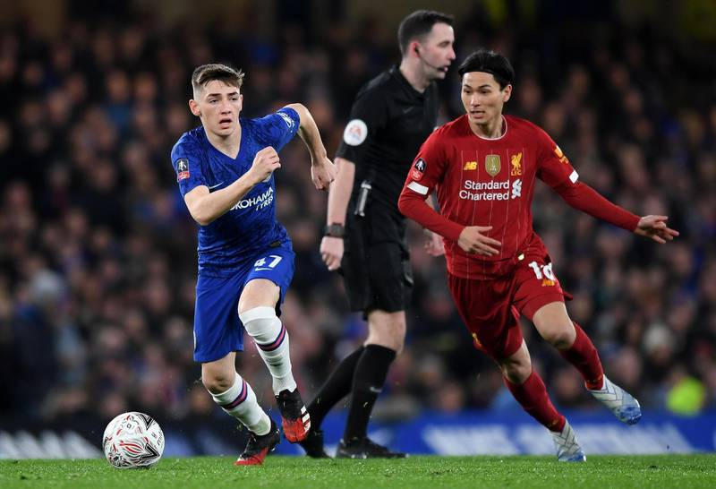 LONDON, ENGLAND - MARCH 03: Billy Gilmour of Chelsea and Takumi Minamino of Liverpool in action during the FA Cup Fifth Round match between Chelsea FC and Liverpool FC at Stamford Bridge on March 03, 2020 in London, England. (Photo by Shaun Botterill/Getty Images)