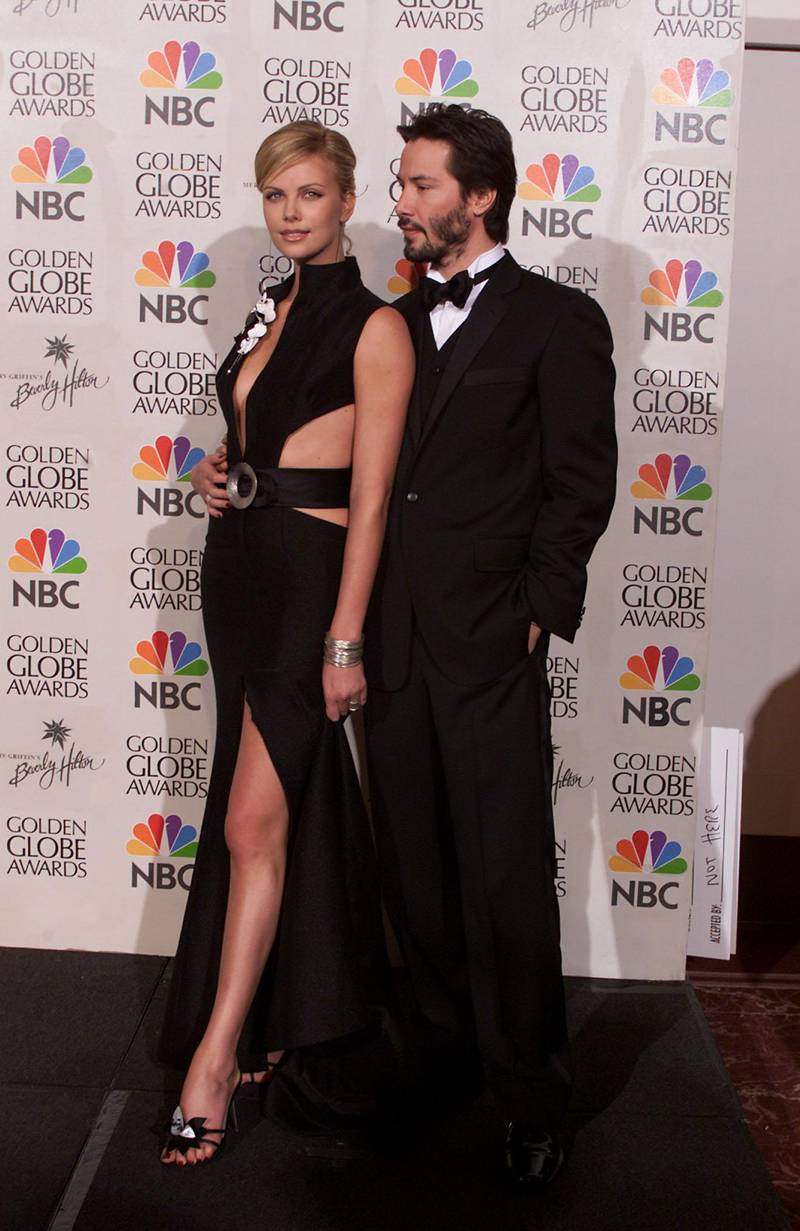Charlize Theron (wearing Armani) and Keanu Reeves at the 58th Annual Golden Globe Awards at the Beverly Hilton in Los Angeles, CA., Sunday Jan. 21, 2001. (photo by Kevin Winter/Getty Images)