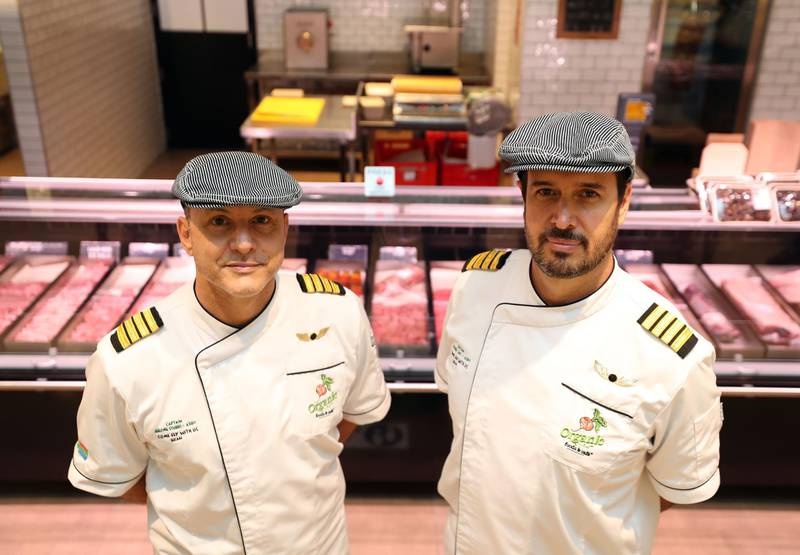 Michiel Smit (R) and Jerome Stubbs. A group of South African pilots on unpaid leave for more than a year become specialist butchers at the Organic Cafe in Dubai on May 30th, 2021. Chris Whiteoak / The National. Reporter: Kelly Clark for News