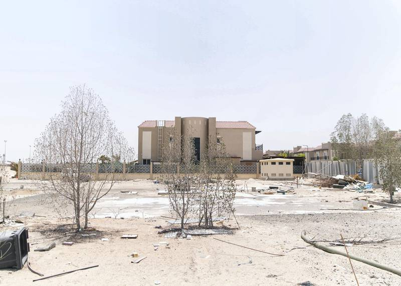 DUBAI, UNITED ARAB EMIRATES - JULY 15 2019.Some residents and investors of Living Legends have paid Dh6m for villas, and pay Dh25,000 a year in service charges but the development still looks like a construction site, with an unfinished golf course, roads, open sewer works near the school, poor lighting and no desert boundary meaning dangerous snakes and animals are regularly getting into the gardens and villas. (Photo by Reem Mohammed/The National)Reporter: NICK WEBSTERSection: NA