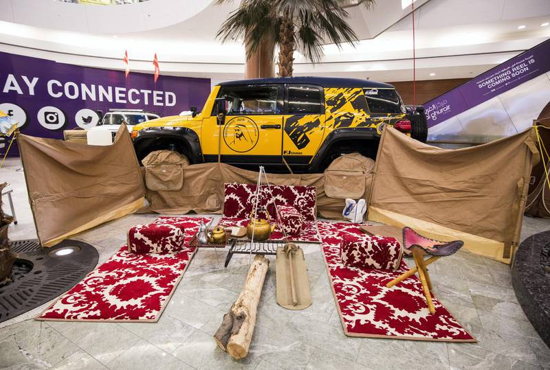 DUBAI, UNITED ARAB EMIRATES -Winner of  King of family car- yellow FJ, desert seating set, wind barrier fabric walls,picnic table, full bathroom set (including shower), a kitchenette for cooking, lights setup for night time while camping, tent with full bedroom equipment  at UAE Offroaders Show at Al Ghurair Centre.  Leslie Pableo for The National for Adam Workman's story