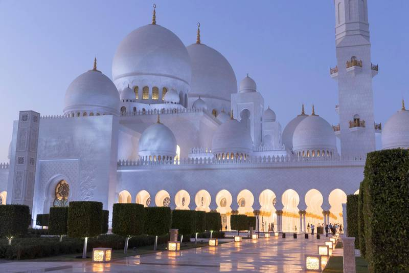 ABU DHABI, UNITED ARAB EMIRATES. 04 DECEMBER 2017. SHORTHAND piece on the anniversary of the Sheikh Zayed Grand Mosque in Abu Dhabi. Exterior view of the mosque at dusk / sunset. Constructed between 1996 to 2007 it was designed by Syrian architect Yousef Abdelky. The building complex measures approximately 290m by 420m and covers an area of more than 12 hectares. (Photo: Antonie Robertson/The National) Journalist: John Dennehy. Section: SHORTHAND.
