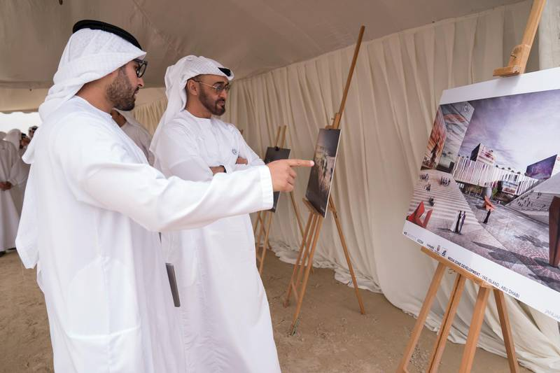 YAS ISLAND, ABU DHABI, UNITED ARAB EMIRATES - March 01, 2018: HH Sheikh Mohamed bin Zayed Al Nahyan, Crown Prince of Abu Dhabi and Deputy Supreme Commander of the UAE Armed Forces (2nd L), inspects urban development and tourism projects, at Yas Bay. Seen with HE Mohamed Khalifa Al Mubarak, Chairman of the Department of Culture and Tourism and Abu Dhabi Executive Council Member (L).  ( Mohamed Al Hammadi / Crown Prince Court - Abu Dhabi ) ---