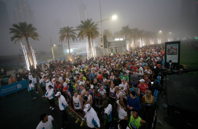 Dubai, United Arab Emirates, Jan 25 2013, 2013 Standard Chartered Dubai Marathon, - Thousands of Runners iline up before sunrise as they wait for the start of the Standard Chartered Dubai Marathon, Jan 25, 2013.  Mike Young / The National