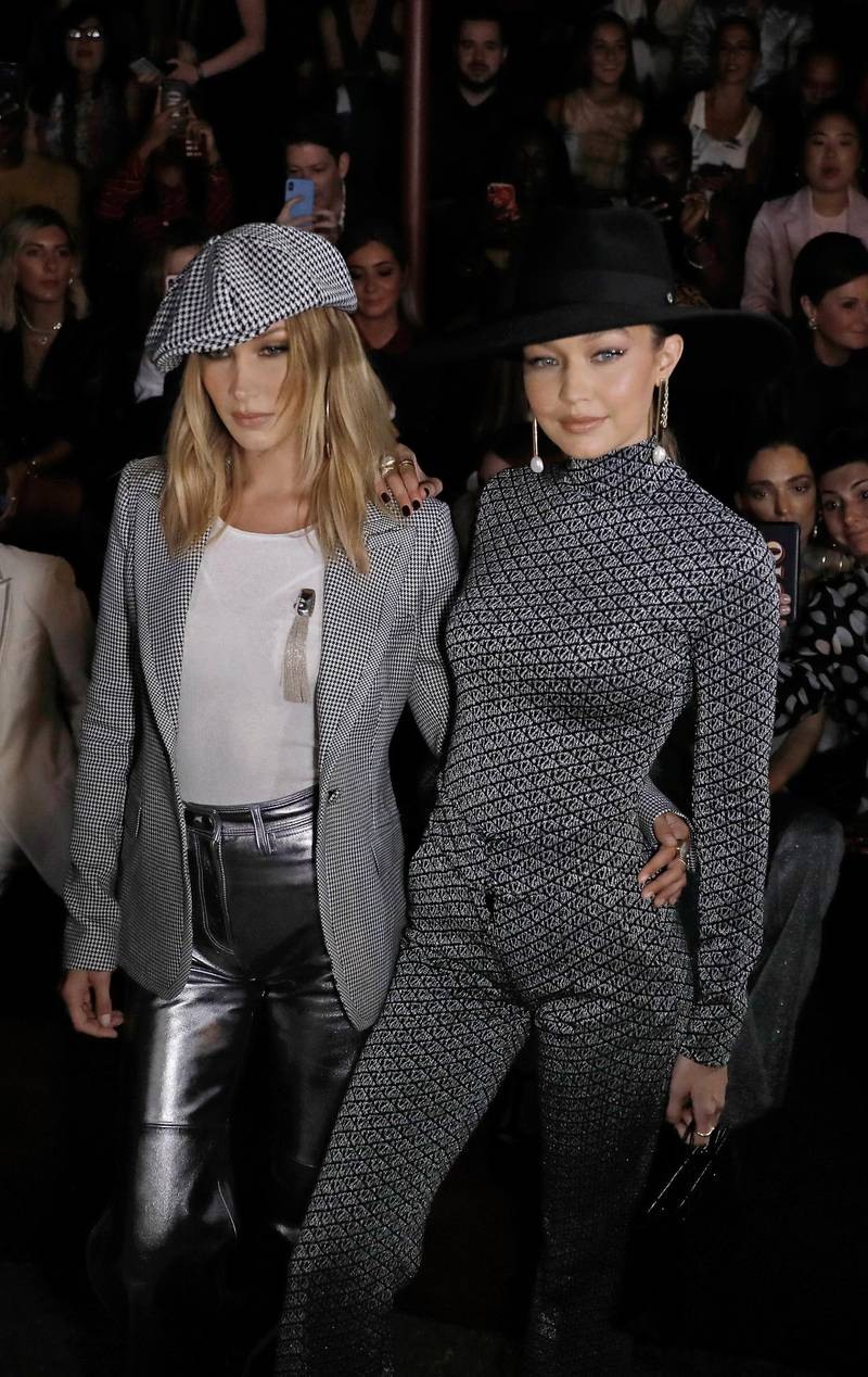 epa07829240 US fashion models Bella (L) and Gigi Hadid (R) pose for photographers before the Tommy Hilfiger fashion show during New York Fashion Week in New York, New York, USA, 08 September 2019. New York Fashion Week shows for designer's Spring and Summer lines are being held from 05 to 11 September 2019.  EPA-EFE/PETER FOLEY