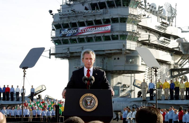 """** FILE ** President Bush declares the end of major combat in Iraq as he speaks aboard the aircraft carrier USS Abraham Lincoln off the California coast, in this May 1, 2003 file photo. Democratic congressional leaders on Tuesday, May 1, 2007 sent Iraq legislation setting timetables for U.S. troop withdrawals to President George W. Bush and a certain veto.  On the fourth anniversary of the president's """"Mission Accomplished"""" speech, Senate Majority Democratic Leader Harry Reid said that Bush """"has put our troops in the middle of a civil war. A change of course is needed.""""  (AP Photo/J. Scott Applewhite)"""