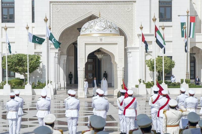 ABU DHABI, UNITED ARAB EMIRATES - November 18, 2018: HH Sheikh Mohamed bin Zayed Al Nahyan Crown Prince of Abu Dhabi Deputy Supreme Commander of the UAE Armed Forces (center R) and HE Imran Khan, Prime Minister of Pakistan (center 2nd R), stand for the national anthem, during a reception held at the Presidential Palace.  ( Rashed Al Mansoori / Ministry of Presidential Affairs ) ---