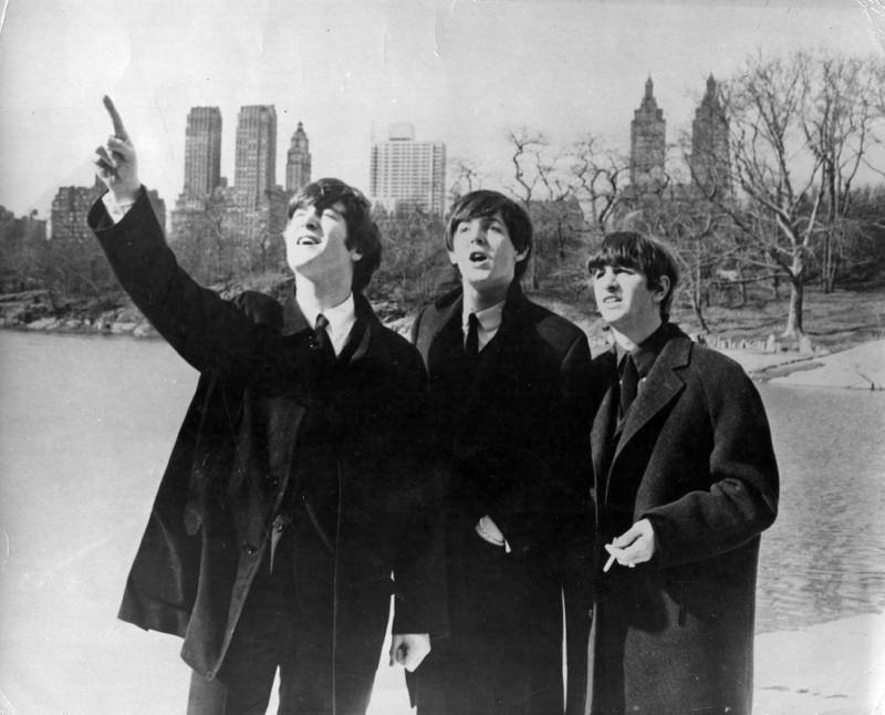 10th February 1964:  Beatlemania has hit big in New York. John Lennon (1940 - 1980), Paul McCartney and Ringo Starr, from left to right, enjoy a few moments away from the screaming fans when police smuggled them out of the side door of their hotel for a visit to New York's Central Park.  (Photo by Keystone/Getty Images)