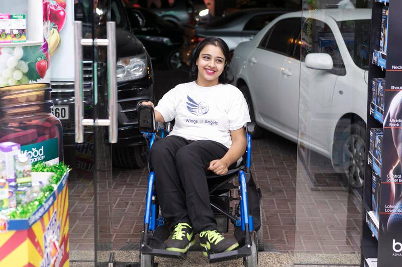 """DUBAI, UNITED ARAB EMIRATES, NOVEMBER 3, 2016.  Shobhika Kalra, uses the newly installed ramp at Aster Pharmacy, next to her home.   Her group """"Wings of Angelz"""", co-founded with her sister Ruchika, campaigns for more ramps to be built around the city.   Photo: Reem Mohammed (Reporter: Ramola Talwar / Section: NA) JOB ID  84514 *** Local Caption ***  RM_20161102_ANGELZ_001.JPG"""