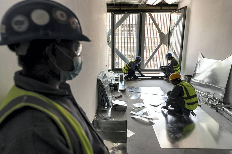 The Polish pavilion at the EXPO 2021 site nears completion. The pavilion has metal birds on the outside and inside that are partially installed along with a special wood panelled interior and exterior on May 2nd, 2021. Antonie Robertson / The National.Reporter: Ramola Talwar for National