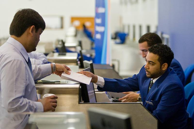 United Arab Emirates - Dubai - August 2, 2010.  BUSINESS: Fly Dubai passenger service agents print a customer a boarding pass at the ticket counter in Dubai International Airport Terminal 2 in Dubai on Monday, August 2, 2010. Amy Leang/The National