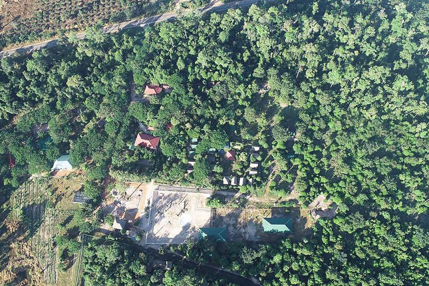 """This undated aerial handout photo released by the Cambodian Ministry of Environment on November 30, 2020 shows the under-construction enclosure for the Asian elephant Kaavan that is arriving in Cambodia from Pakistan, at the Kulen Prom Tep Wildlife Sanctuary in Oddar Meanchey province.  - RESTRICTED TO EDITORIAL USE - MANDATORY CREDIT """"AFP PHOTO / Cambodian Ministry of Environment """" - NO MARKETING - NO ADVERTISING CAMPAIGNS - DISTRIBUTED AS A SERVICE TO CLIENTS  / AFP / Cambodian Ministry of Environment / Handout / RESTRICTED TO EDITORIAL USE - MANDATORY CREDIT """"AFP PHOTO / Cambodian Ministry of Environment """" - NO MARKETING - NO ADVERTISING CAMPAIGNS - DISTRIBUTED AS A SERVICE TO CLIENTS"""